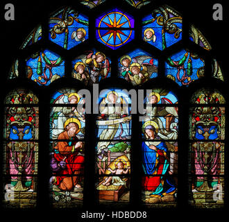 Stained Glass in Sainte Eustache Church in Paris, France, depicting a Nativity Scene at Christmas - Stock Photo