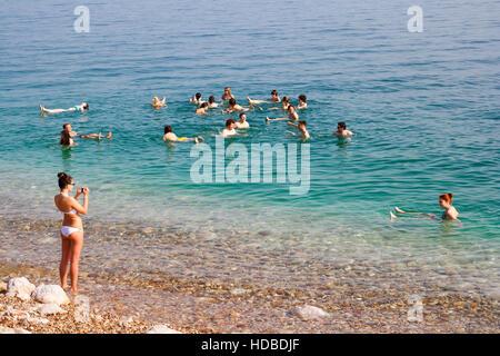 People floating in the Dead Sea in Ein Gedi, Israel - Stock Photo
