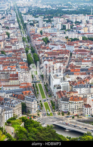 Grenoble city, France. Picturesque aerial view from Bastille in summer cloudy day - Stock Photo