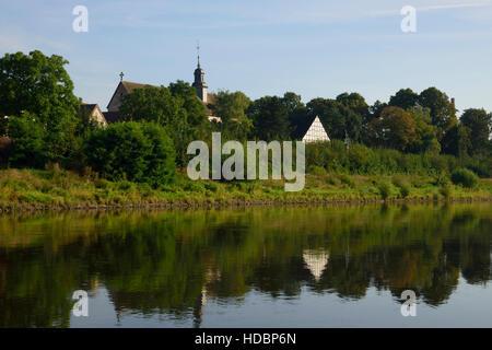 Church at river Weser near Höxter, North Rhine-Westphalia, Germany - Stock Photo