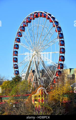 Winter Edinburgh Scottish Christmas ferris big wheel fairground ride on Princes Street Scotland uk in association - Stock Photo