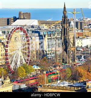 Scotland uk Edinburgh European Christmas Market & Ferris fairground ride East Princes Street gardens Scott Monument - Stock Photo