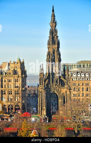 Edinburgh New Town Scotland UK Scott Monument Princes Street  red stall canopies in Scottish Christmas Market in - Stock Photo