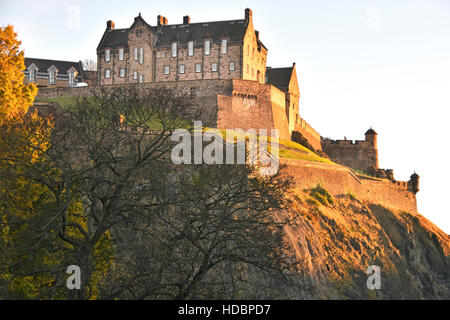 Scottish castle Edinburgh Castle Rock Scotland uk and late afternoon winter sunshine in urban landscape in the town - Stock Photo