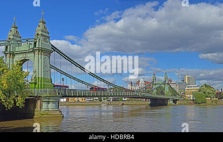 Hammersmith Bridge over the Thames in London as seen from the Thames Path National Trail in the U.K. - Stock Photo