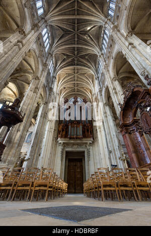 Interior and nave of Church of Saint Eustache with vaulted arches and pipe organ. Les Halles, Paris, France - Stock Photo