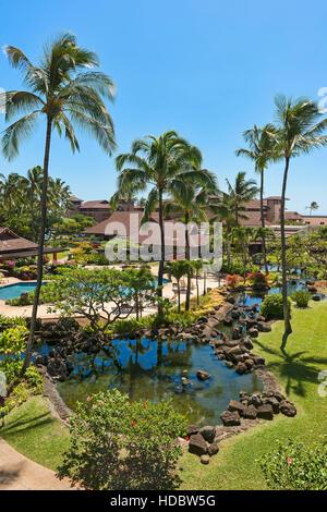 Hotel resort with pool and palm trees, Poipu, Koloa, Kaua'i, Hawaii, USA - Stock Photo