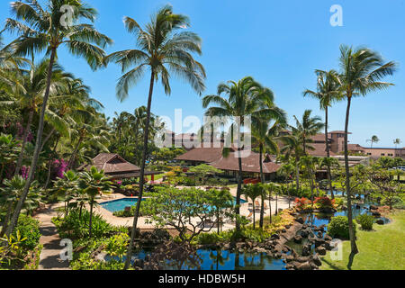 Hotel resort with pool and palm trees, Poipu, Koloa, Kaua'i, Hawaii, USA - Stock Photo