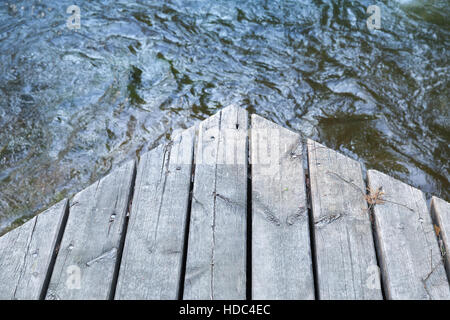 Corner of an old wooden pier, vintage green toned photo, old style effect - Stock Photo