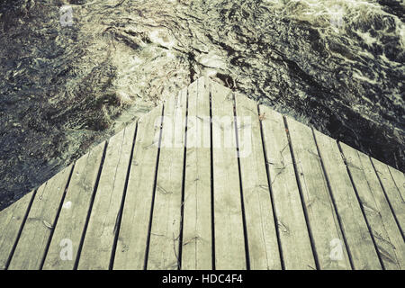 Corner of an old wooden pier, vintage green toned photo, old instagram style effect - Stock Photo