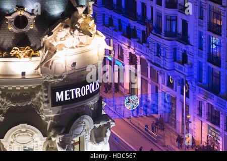 Madrid, Spain. Metropolis building at Calle de Alcala and Gran Via. - Stock Photo