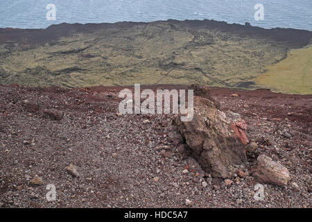 The extent of the lava field seen over volcanic rocks of Eldfell, Heimaey, Vestmannaeyjar Islands, southern Iceland - Stock Photo