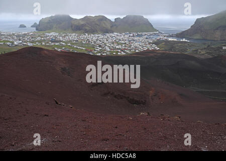 Heimaey seen over volcanic rocks and lava field from of Eldfell, Heimaey, Vestmannaeyjar Islands, southern Iceland - Stock Photo