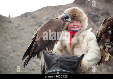 Bayan Ulgii, Mongolia, October 4th, 2015: Eagle huntress  with her Altai Golden Eagle - Stock Photo