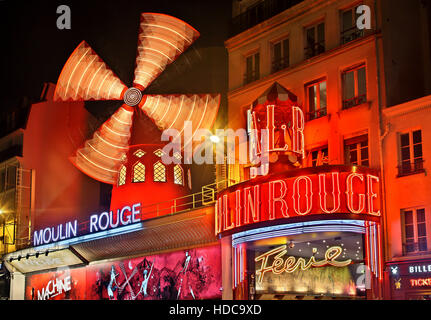 Moulin Rouge ('red mill') one of the world's most famous cabarets, at Pigalle district, close to Montmartre, Paris, - Stock Photo