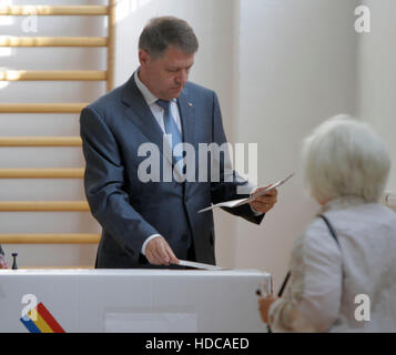 BUCHAREST, ROMANIA - MAY 05, 2016: Romanian President Klaus Iohannis casts his vote in local elections. - Stock Photo