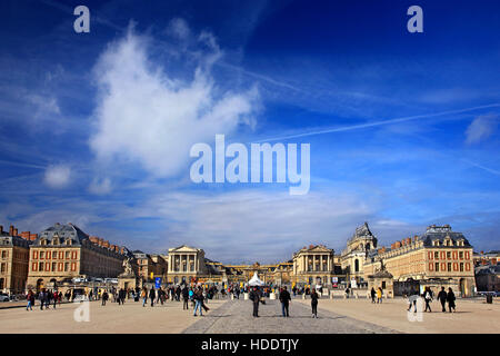 Tourists outside the Palace of Versailles, France. - Stock Photo