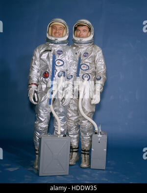 Official NASA portrait of Gemini-3 mission prime crew astronauts Gus Grissom (left) and John Young wearing spacesuits - Stock Photo