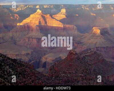 The sun sets over the South Rim of the Grand Canyon National Park June 3, 2010 in Grand Canyon Village, Arizona. - Stock Photo