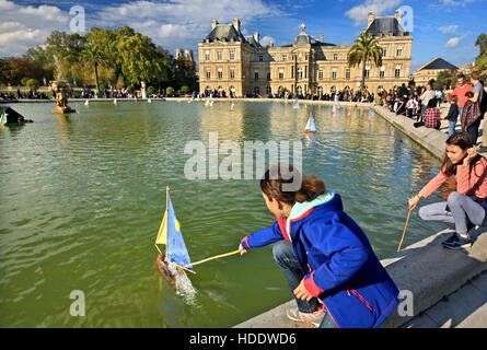 Retro wooden boats - toys in the pool in front of the Luxembourg Palace (Palais) in the Luxembourg Garden (Jardin), - Stock Photo