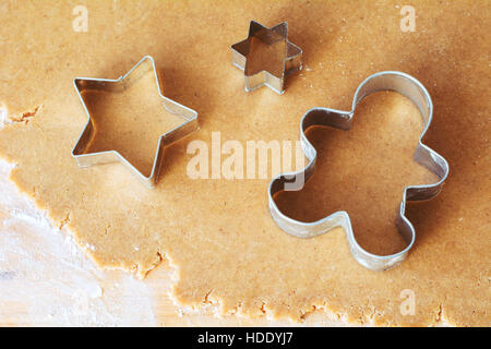 Gingerbread cookie dough and cookie cutters. Close up view. Christmas holiday baking concept - Stock Photo