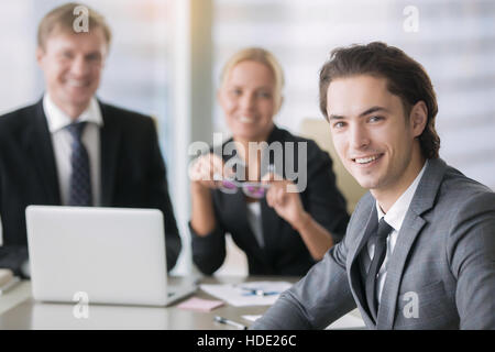 Group of business people and a smiling young man
