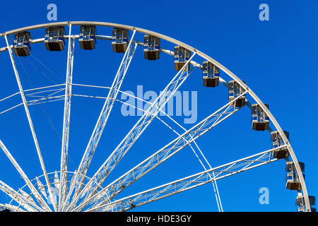 Giant observation wheel in Winter Wonderland, a Christmas fair in London - Stock Photo
