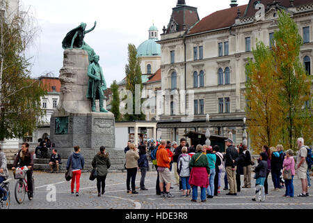 Tourist gathered on Presern Square beneath Presern monument , Ljubljana, Slovenia - Stock Photo