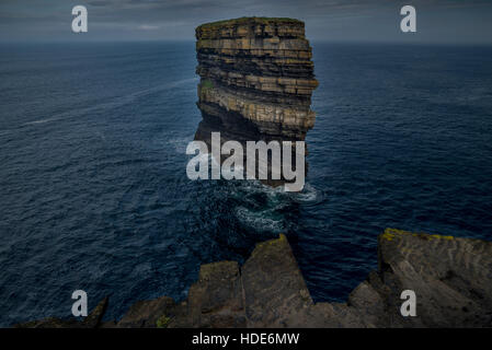 The coast of Downpatrick Head and spectacular lonely sea stack Dun Briste - Stock Photo