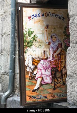 Old street full of traditional restaurants in Madrid, including Mesón del Champinon (Mushrooms). Spain. - Stock Photo