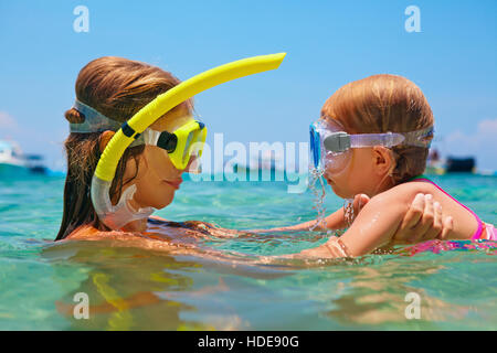Happy family. Mother with baby girl dive underwater in sea pool. Healthy lifestyle, active parent, water sport outdoor - Stock Photo