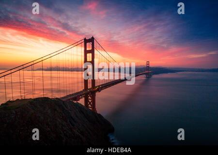 Colorful sunrise at the Golden Gate Bridge in San Francisco, California, USA - Stock Photo