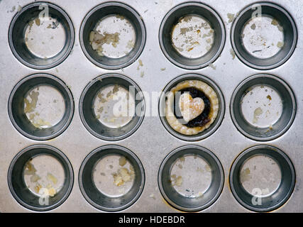 Baked homemade mini mince pie in a baking tray - Stock Photo