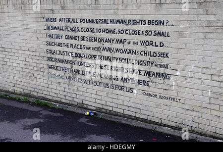 Quote painted on a Shankill housing estate wall in west Belfast - Stock Photo