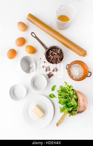 egg chocolate sugar butter flour mint herb leaf - Stock Photo