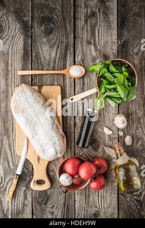 Ingredients for  bruschetta on the wooden table - Stock Photo