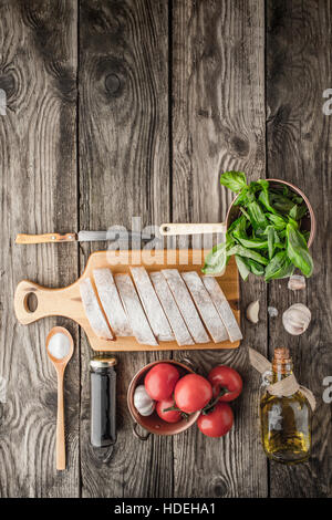 Ingredients for  bruschetta on the wooden table vertical - Stock Photo