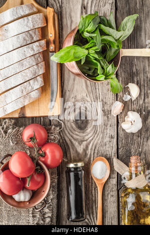 Ingredients for  bruschetta on the wooden table top view - Stock Photo