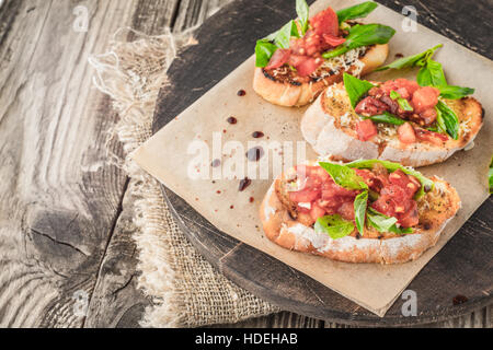 tomato basil bread seasoning vegetable board food - Stock Photo
