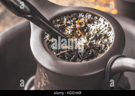 Brewing tea in the Chinese teapot - Stock Photo