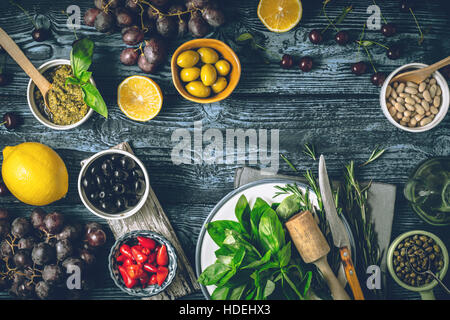 Concept of Mediterranean cuisine. Different fruit , herbs and appetizers on the wooden table horizontal - Stock Photo