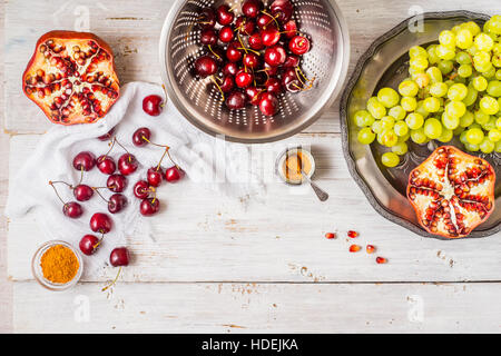 Different fruit and spices on the white wooden table. Concept of oriental fruits horizontal - Stock Photo