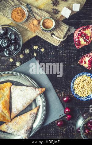 baklava walnut jam star anise puff buns coffee - Stock Photo