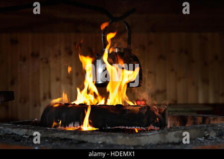 Kettle is put on fire, Finland - Stock Photo