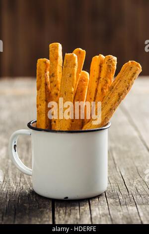 Crispy bread sticks in old cup. - Stock Photo