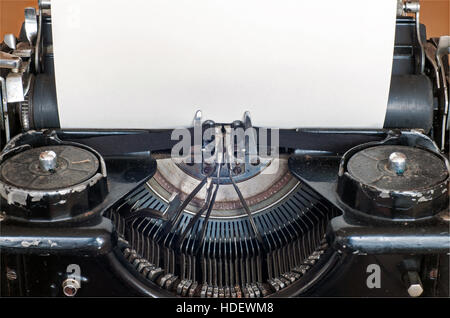 Old typewriter and blank sheet of paper for your text - Stock Photo