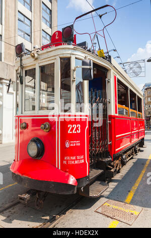 Istanbul, Turkey - July 1, 2016: Old red tram goes on Istiklal street in Istanbul, popular public transportation