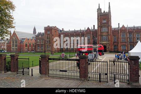 Queens University Belfast main building and modern Routemaster Bus,Northern Ireland,UK - Stock Photo