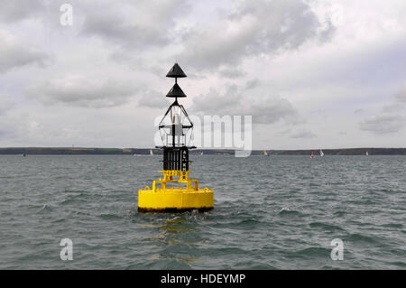 Al Khor Northerly Cardinal buoy with yachts sailing and Dale in the background on a calm autumnal day. - Stock Photo