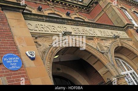 Belfast Falls Rd Carnegie Branch Library Facade & Entrance, with JG Devlin blue plaque - Oranmore Street - Stock Photo
